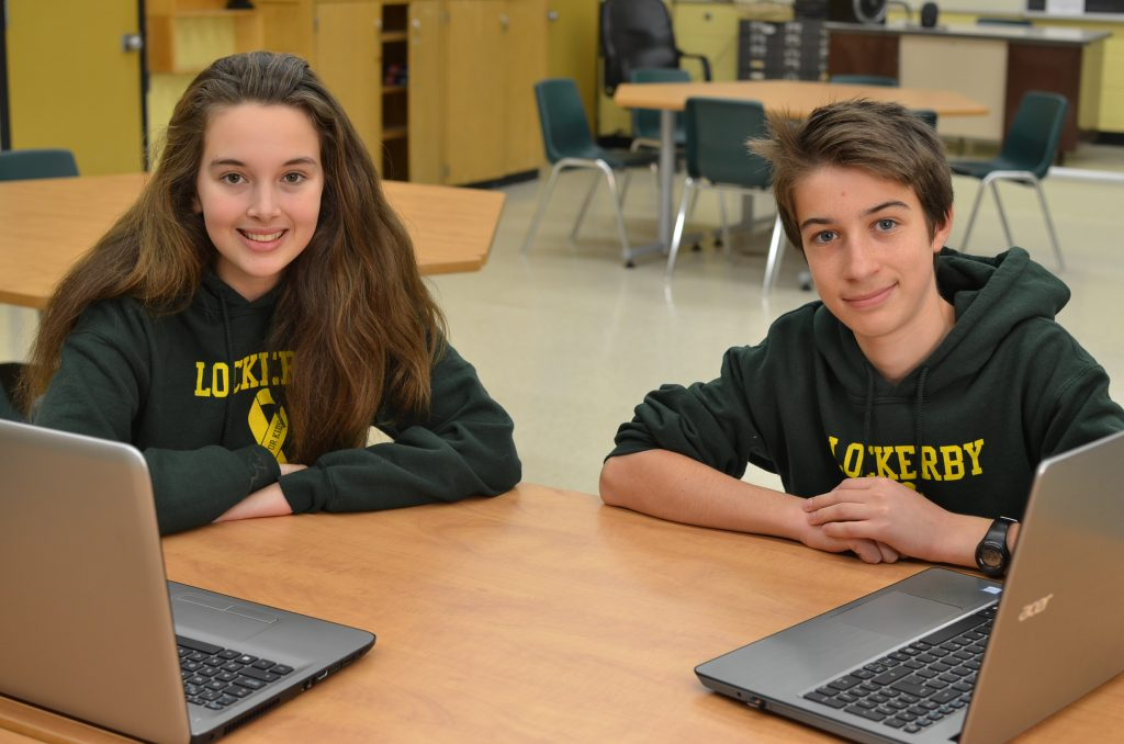 Two students with laptops.