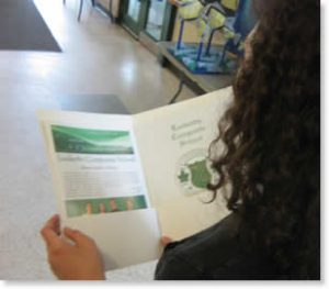 Student looking at brochure.