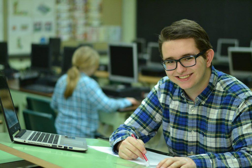 Student at a drafting table