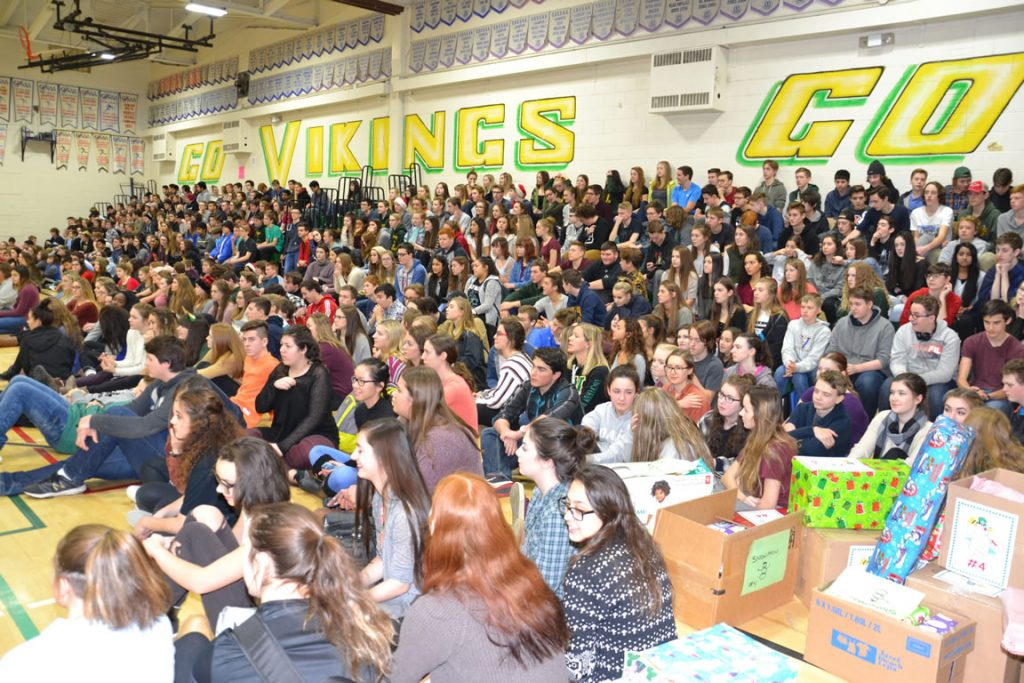 View of gym packed with students.