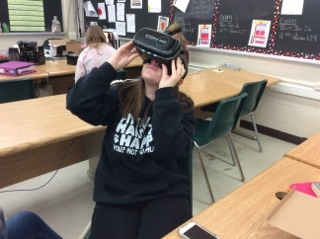 Student using virtual reality goggles.