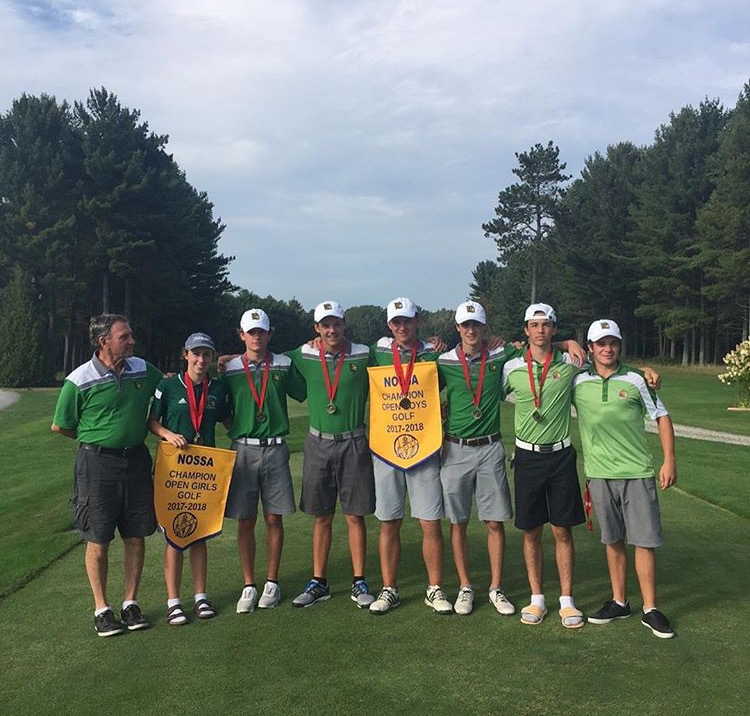 Golfers posing for photograph with NOSSA banner