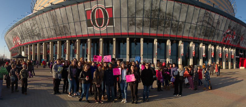 Students standing in front of Ottawa arena.