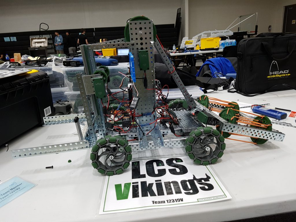 image of the competition robot with a sign that reads