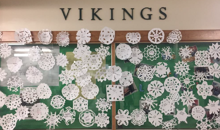 Many paper snowflakes on a cabinet