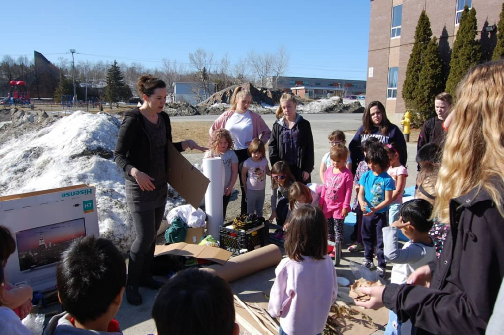 Sarah King Gold gather with lockerby and macleod students outside to talk about their project
