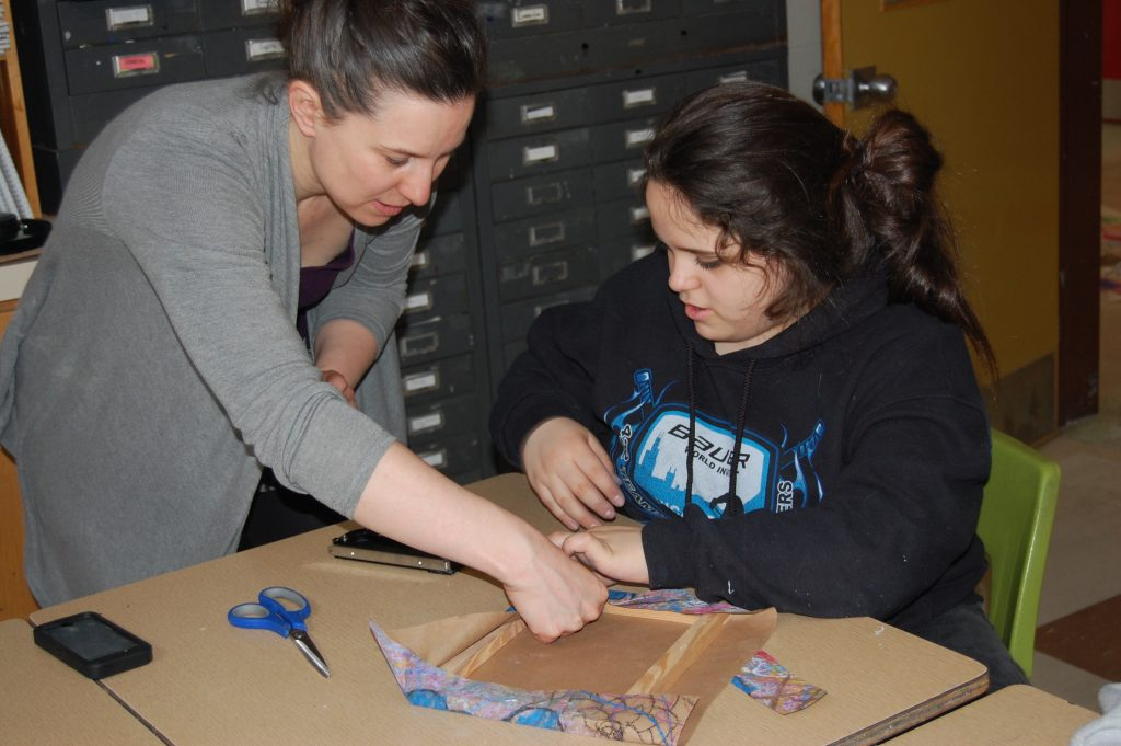 sarah king gold helps a lockerby student with her project