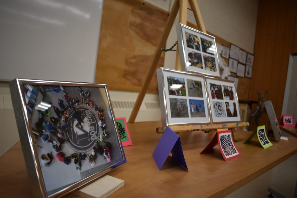 table displaying a variety of different artworks created by students during the program
