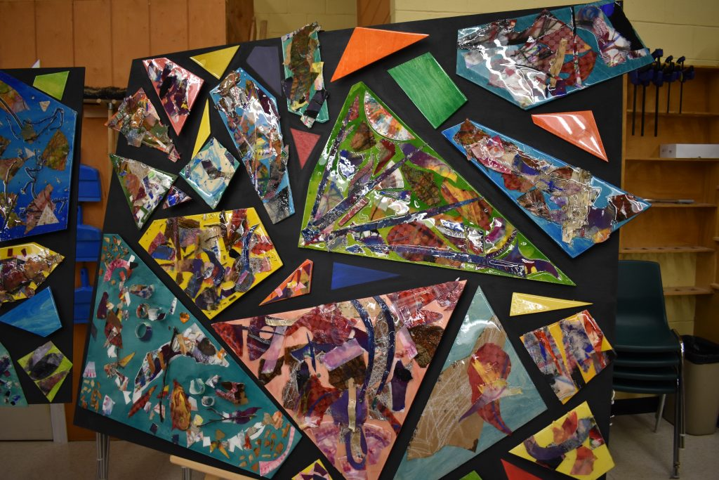 large canvas displaying larges geometric shapes decorated by students