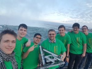 A group photo of Lockerby Robotics in front of Niagara Falls.