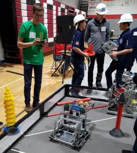 A Lockerby student controlling our robot at a VEX Robotics Competition.