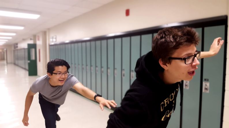 Student chasing another in hallway