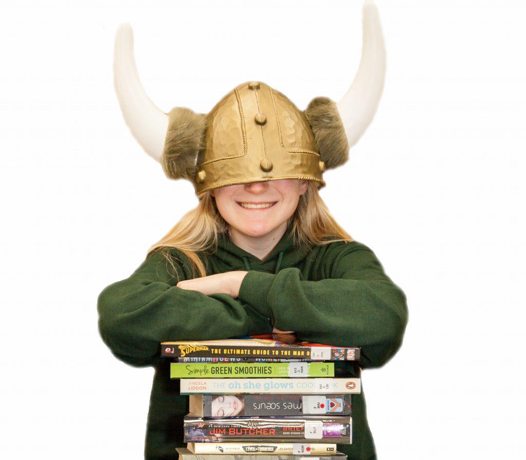 Student wearing oversized Viking helmet