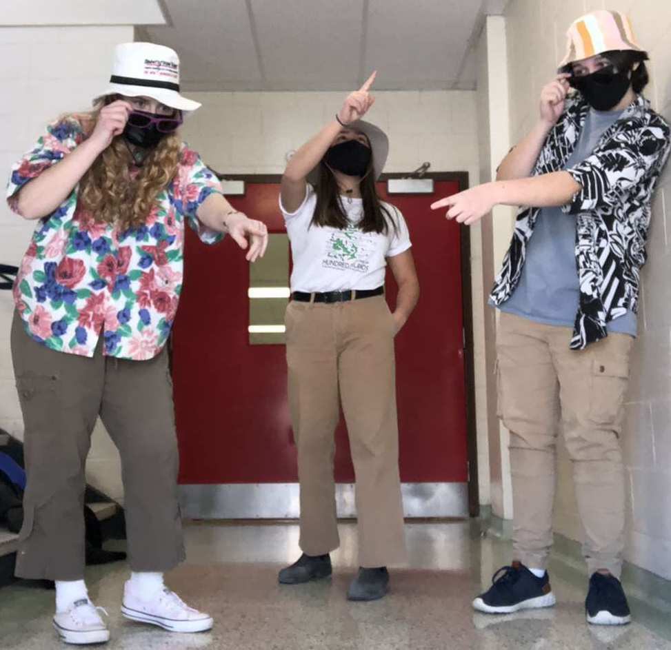 3 students in tourist clothing
